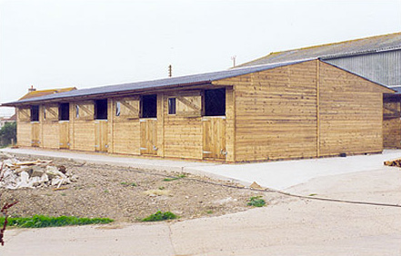 Phase 1 of a large successful livery yard. Block of 10 back to back Levade stables. Excellent use of available space.