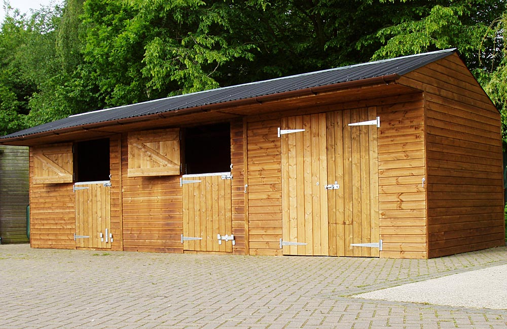 3m x 3m pony boxes and similar sized store with barn doors. Cost of these units 2 Stables 3m x 3m £2015 , 1 Store £765, Double doors £225, Overhang lining 9m £162 : TOTAL: £3167 +VAT