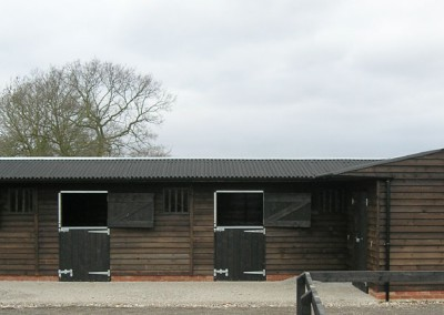 Very smart block of 3 stables and a corner barn featuring attractive, dark stained ,feather edge exterior cladding which offers a rustic appeal that some planning authorities may prefer.