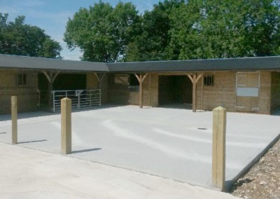 Very much a Bespoke yard with canopy on gable ends and gates on front of barn for livestock.