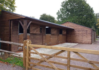 Large workshop attached to 3 stables with 1.2m overhang includes feature post for effect.