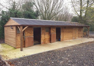 A delightful private yard of two stables  and decent size barn all with 1.2m canopy . Great looking feature posts positioned at either end of the block so as to keep frontage clear.