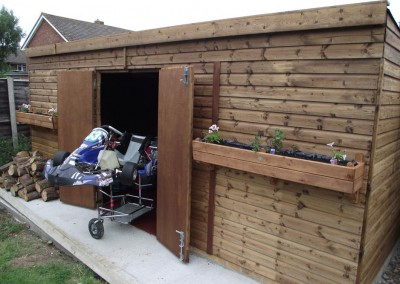 """Garden workshop/ store as required, supplied to """"Prokart"""" for the meticulous assembly of some quite serious racing go karts. Building was lined internally for additional strength and security, double doors as required."""
