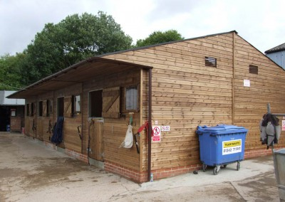 Large back to back stable complex comprising of 8 stables offering economic, yet spacious use of a fairly compact area. Erected at a busy riding school near the South Downs.