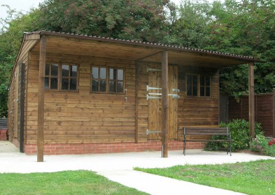 Three buildings in one!! At the rear a store shed, and at the front a dog grooming parlour and a separate office.The roof canopy is enhanced by the two feature support posts. All the walls were insulated and will provide warm, draught-free facilities for the delighted occupants.This somewhat awkward corner of the garden has been transformed into a cosy, inviting place to be.