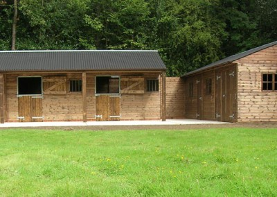 Stable yard with adjacent bespoke large store room / games room / teenage den / workshop.