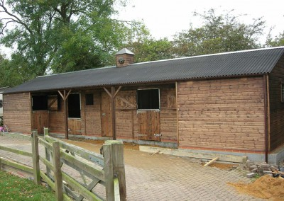 Wonderful use of available space in this stable block. Note the inward opening tack room door to facilitate adjacent doors.
