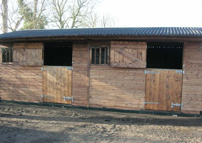 Mobile stable block – robust, tow anywhere steel skids, with traditional timber building.