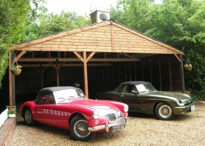 Large car port protecting your cherished vehicles! 1962 Red MGA, 1622cc 4cylinder. One of the very last built for export. 1995 Green MGR V8. One of only 2000 made. A whopping 3.9 litres! Because they're worth it!!!