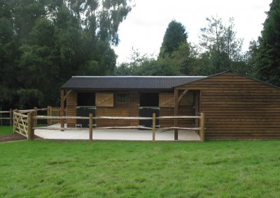 Two stables and a corner store and tack room. Featheredge cladding with a 1.2m roof overhang with two end feature posts and gallows brackets.