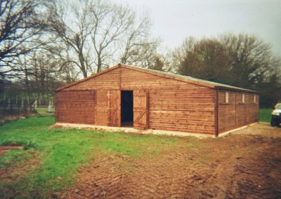 American Barn, 36' x 34', containing 6 stables 12' x 12'. Windows can be replaced with stable top doors.