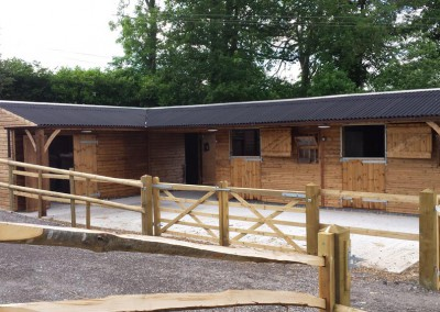 Two stables and a large store with covered walkway for shoeing, clipping, grooming, all with 1.2m roof overhang.