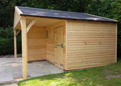 Supplied with clear preservative but to be painted blue at later a date as the client required. Incorporating a small stable and a good store room with a lovely covered porch and grey felt shingles. How to impress the neighbours!