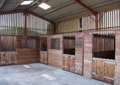 Internal stables erected into an existing barn. Quick, economic, light and well ventilated.