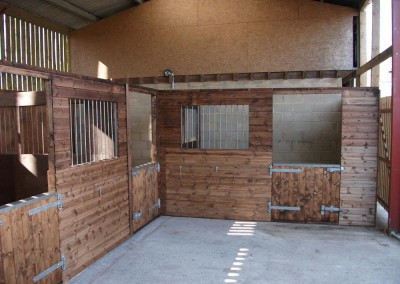 Internal stables for ponies with appropriate sized doors for a local school.