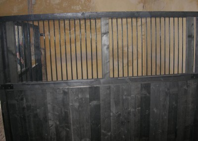 Grills in dividing partition have been painted black and made especially for this project.
