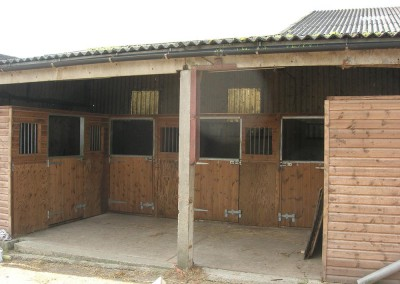 Five compact stables for ponies at a thriving livery yard.