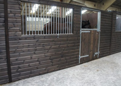 Internal stabling at Treetops Stud featuring large galvanised grills front and back.
