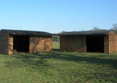 Two mobile field shelters 7.2m x 3.6m (24ft x 12ft) with added benefit of optional front roof canopy. Further option is the single entrance as shown ready to accept an 8ft gate at a later date.