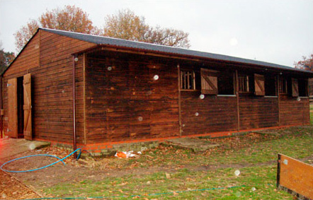 Purpose built American Barn. Three 3.0 x 3.6 Stables and 3.0 x 3.6 Tack Room with 2.4m internal walkway replacing an existing make shift Stable Block.