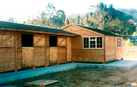 A row of 3m x 3m stables and a 6m x 6m office and social house.