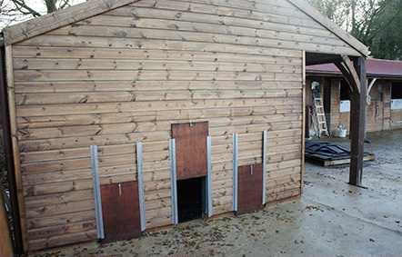 Kennel house within a bespoke stable complex.