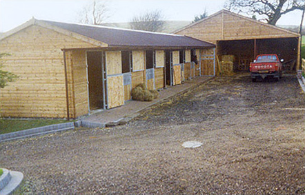 Superb block of six Levade stables. Features include 1.2m overhang steel frame door set, extra deep chew strips and a large adjoining garage and store.