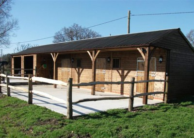 Bespoke stable and garage complex featuring 5ft roof overhang. Note stepped base to overcome sloping ground.