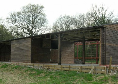 A unique static shelter and store, four open bays and one enclosed, ideal for sheep or horses.