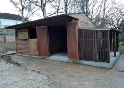 Implement store, livestock unit and a lean-to log store all built to the required sizes.