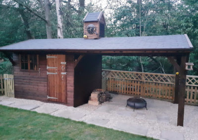 Fabulous covered area for socialising and attractive garden store.